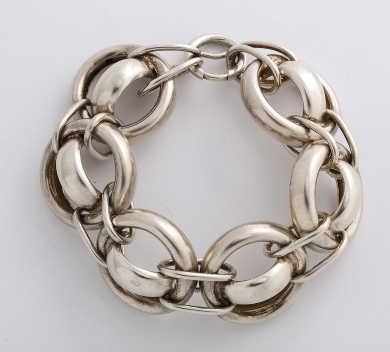 Unusually large for a Victorian bracelet, bold, and chunky, this silver bracelet is as stunning as it is fun. The links are round with a horizontal curved link in the center. Each inch large circle is connected by two horizontal links to its