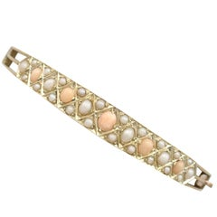 1880s Antique Victorian Coral and Seed Pearl Yellow Gold Bangle