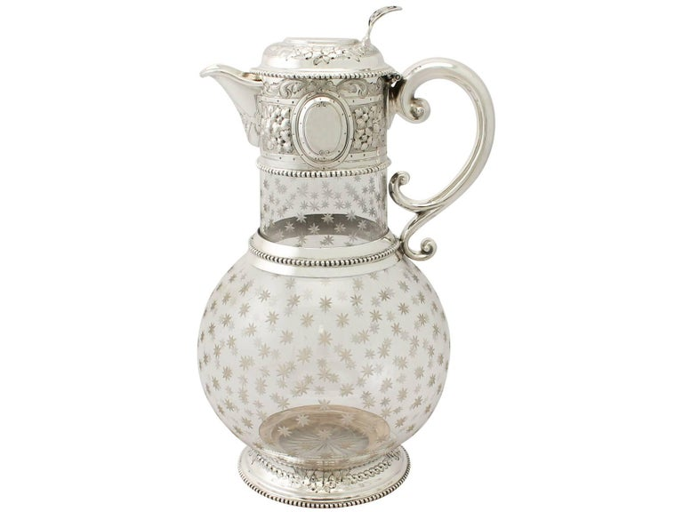 An exceptional, fine and impressive antique Victorian acid etched glass and English sterling silver mounted claret jug; an addition to our wine and drink related silverware collection.  This exceptional antique Victorian sterling silver and cut