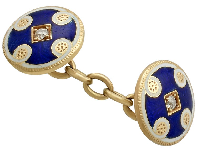 An impressive pair of antique Victorian 0.24 carat diamond and enamel, 18 karat yellow gold cufflinks; part of our diverse antique jewelry and estate jewelry collections.  These fine and impressive antique cufflinks have been crafted in 18k yellow