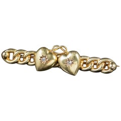 Antique Victorian Diamond Double Heart Brooch 15 Carat Gold, circa 1900