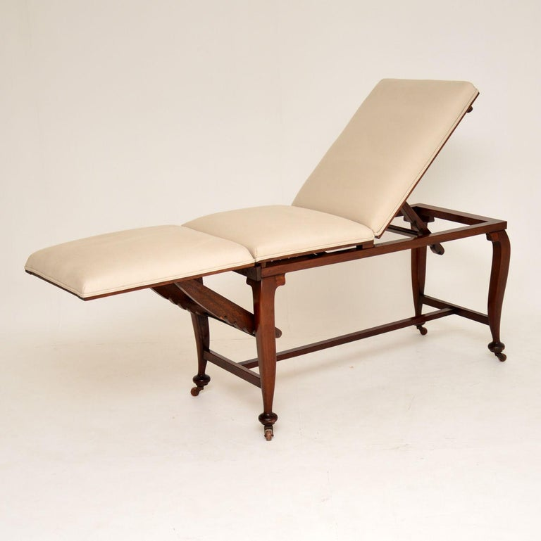 Antique Victorian solid mahogany doctors bed with many different positions available with the help of adjustable supports.