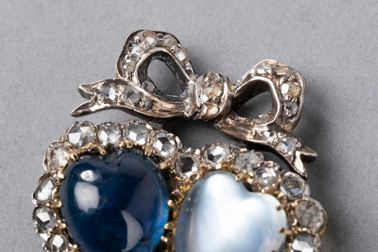 Women's Antique Victorian Double Hearts Sapphire and Moon Stone Brooch For Sale