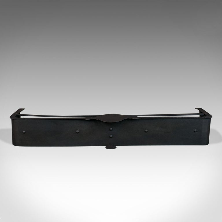 This is an antique Victorian fire surround. An English, fire fender handcrafted in iron dating to the late 19th century, circa 1890.