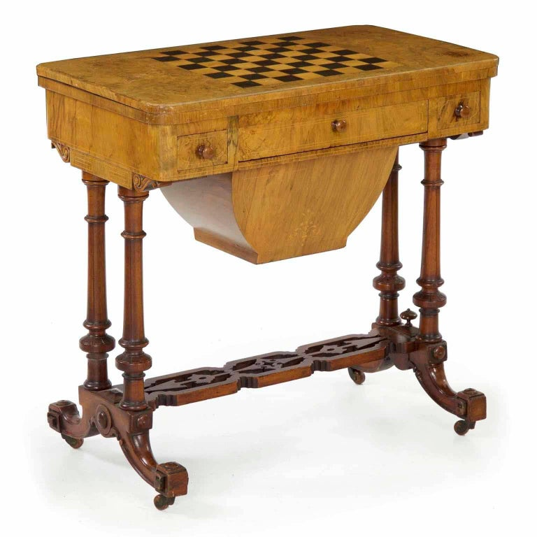 This is such a fun piece with a wealth of uses for enjoyment in the home. Designed first and foremost as a beautiful object, the table is very finely crafted in bleached burl walnut in the top and stained solid walnut in the base; this is