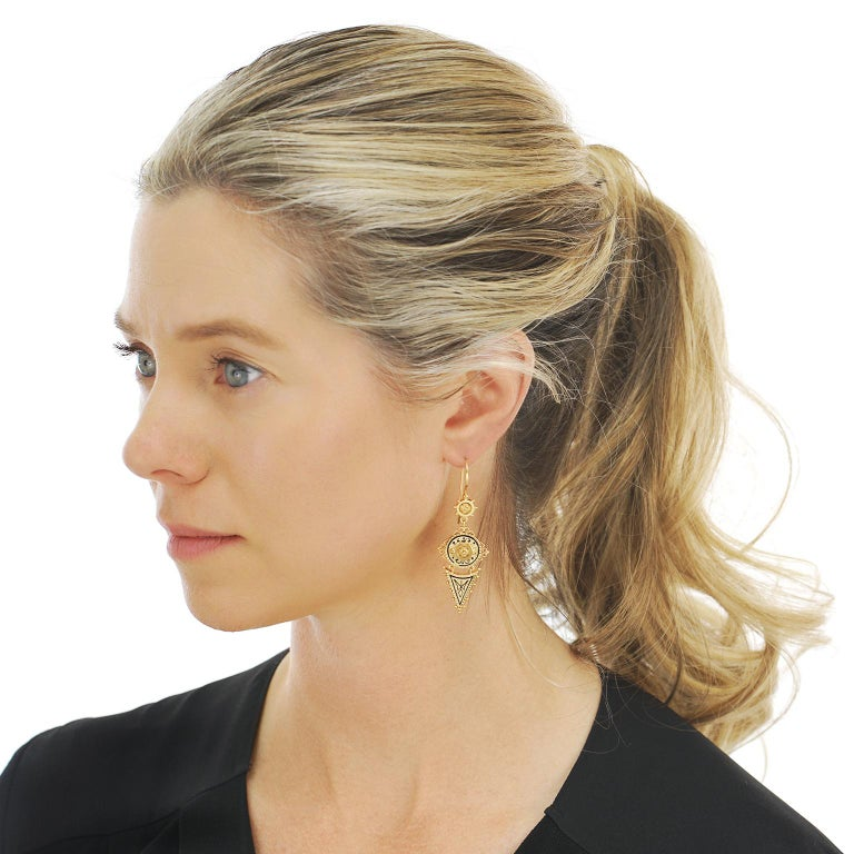 Circa 1880s, 14k.   These elegantly long, boldly geometric earrings are beautifully enameled, festooned with golden balls, and display a delightfully flirty movement. The look is vintage chic at its antique best. Nineteenth-century gold earrings