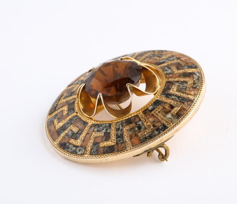 Dazzling gold and agate Scottish brooch is made with an undulating Greek Key pattern in gold and granite with a flower burst large citrine pulling you in to the center. One of the most beautiful Scottish brooches I have found was artist made between