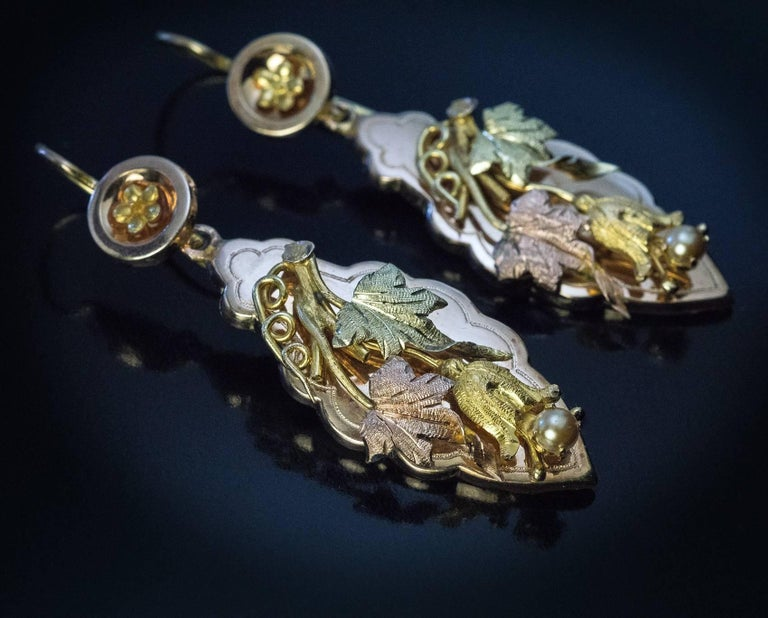 Circa 1880  Antique Victorian era dangle earrings are designed as polished rose gold panels applied with three-color gold hand-engraved grape vines. Each vine is accented with a half pearl.  Weight 4.8 and 4.9 grams  Total length with ear wire 62 mm