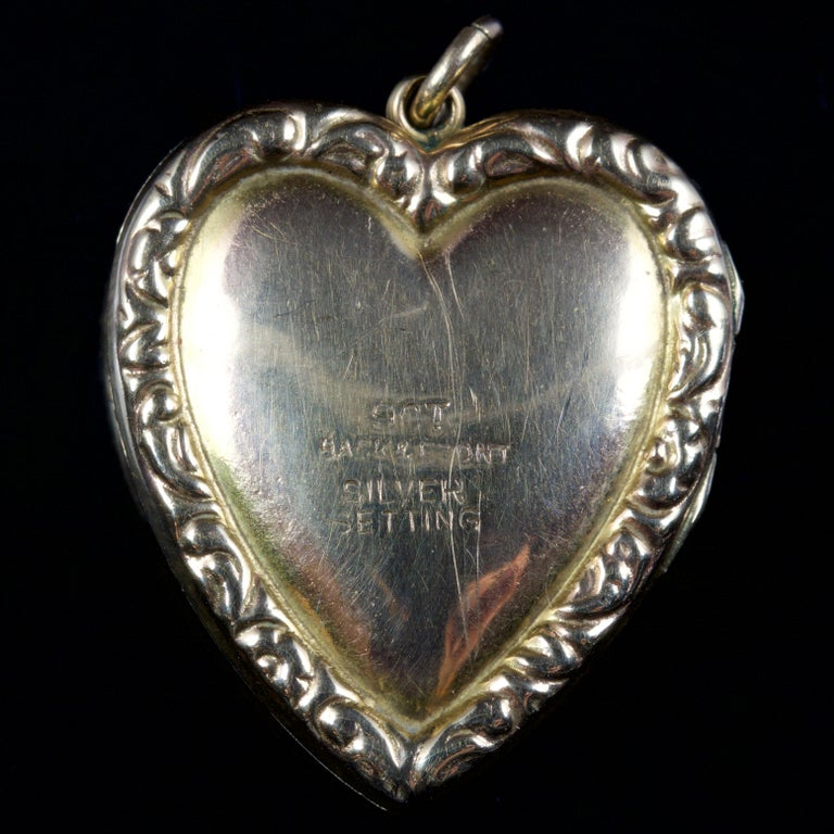 This beautiful Victorian Garnet and Pearl heart locket is, Circa 1900.  The locket displays a cluster of Garnets in the centre, surrounded by engraved leaves with lustrous Pearls set into them.  It is set in 9ct Gold and a Silver.  The Garnet is a