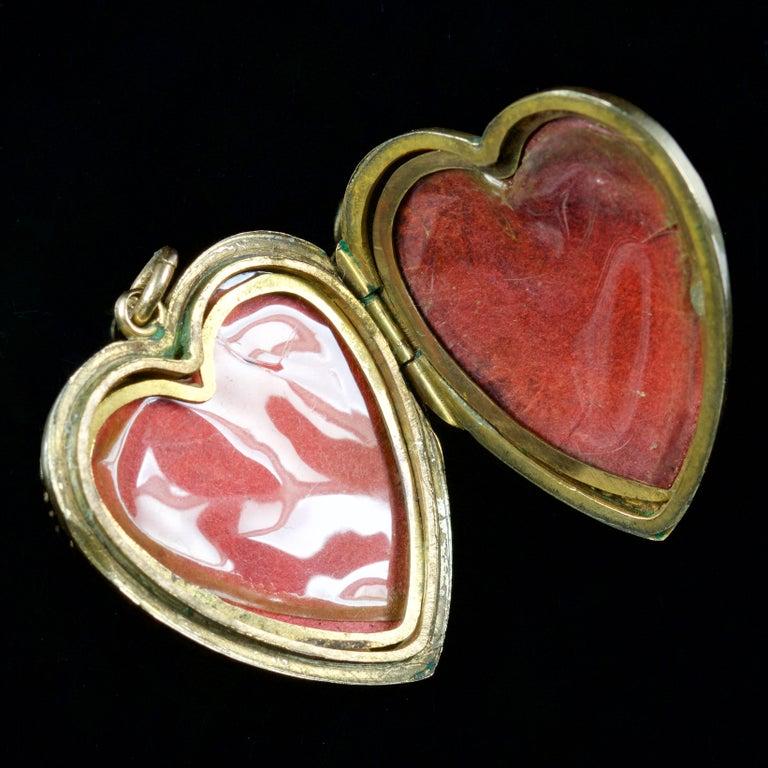 Women's Antique Victorian Heart Locket Garnet Pearl 9 Carat Silver, circa 1900 For Sale