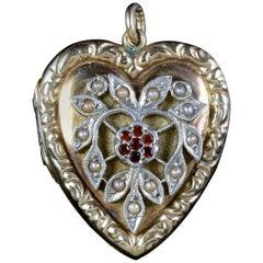 Antique Victorian Heart Locket Garnet Pearl 9 Carat Silver, circa 1900