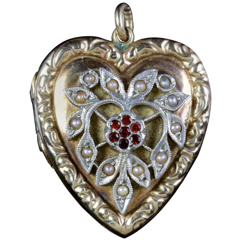 Antique Victorian Heart Locket Garnet Pearl 9 Carat Silver, circa 1900 For Sale
