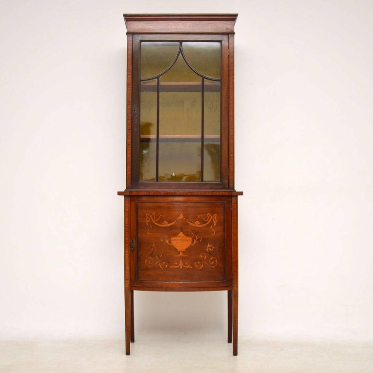 This slim antique mahogany and satinwood display cabinet dates circa 1890s  period and is in good - Antique Victorian Inlaid Mahogany Display Cabinet At 1stdibs