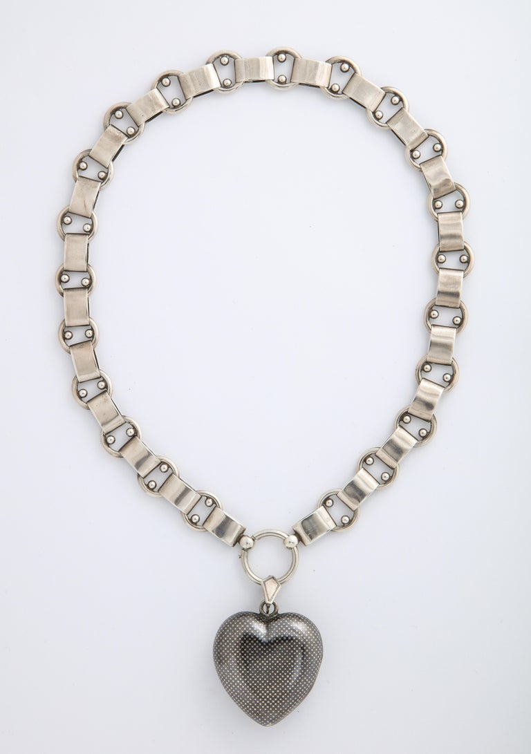 We are excited to show this magical example of Niello jewelry in the shape of a grand sized heart with small geometric squares covering the entire surface. .The tiny squares on the silver were made by a jeweler who incised lines on the metal and