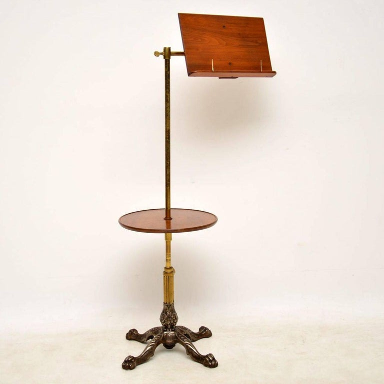 This antique Victorian reading table stand was made by the top Victorian makers John Carter. See the lovely label on the back. Each section is fully adjustable and there is a tilt facility for the top reading section. The metal is very decorative