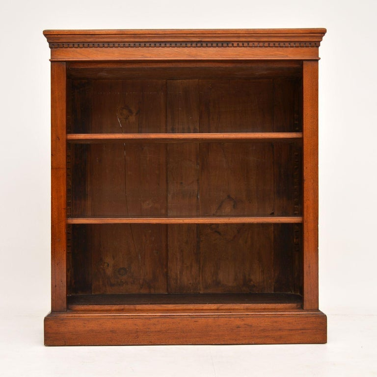 This antique Victorian mahogany bookcase is in excellent original condition and has loads of character.  It has dental mouldings around the top, adjustable shelves on sharks teeth supports and sits on a plinth base.  It has a lovely warm color