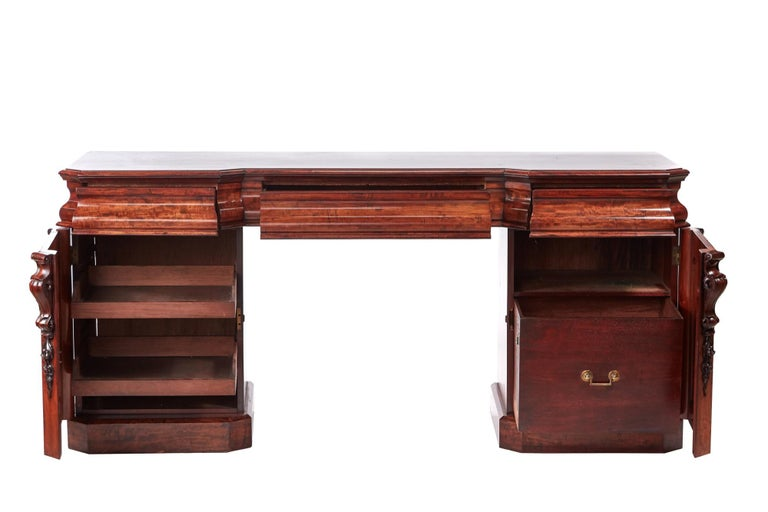 Quality 19th century Victorian antique mahogany sideboard. It has a lovely quality mahogany top with three shaped frieze drawers, supported by two pedestals with quality carvings and a fitted interior. It stands on a plinth base.  Wonderful color