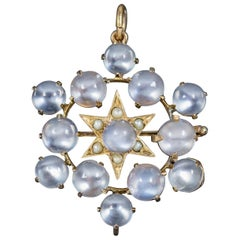 Antique Victorian Moonstone Pearl Star Pendant Brooch 18 Carat Gold, circa 1880