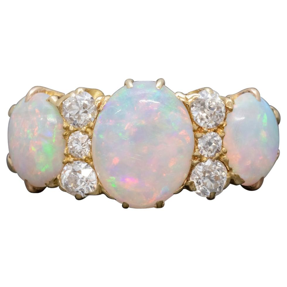 4700dbf7253f6 Arts & Crafts Peridot Ruby Opal Ring, circa 1900