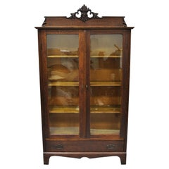 Antique Victorian Oak and Glass Northwind Face 2-Door Bookcase China Cabinet