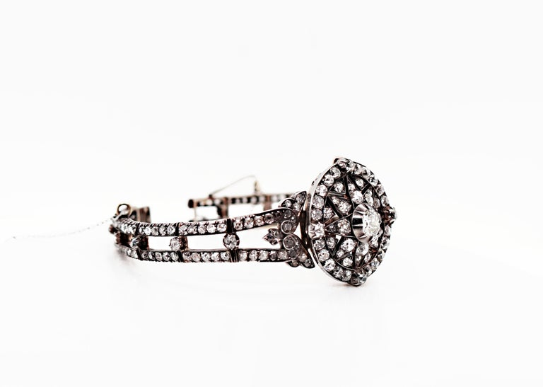 An exceptional piece handmade in the mid 1800's that can be worn as both a bracelet and pendant. This rare piece of jewellery is in immaculate condition for its age, featuring an impressive total of 125 old cut diamonds all mounted in silver on