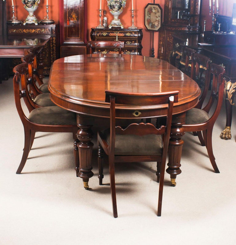 This is a fabulous dining set comprising an antique Victorian mahogany oval extending dining table, circa 1860 in date with a set of eight bespoke Regency style mahogany bar back dining chairs.