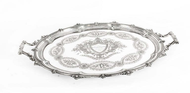 This is a magnificent antique English Victorian oval silver plated twin handled tray by the highly sought after silversmiths Mappin & Webb, Sheffield, circa 1880 in date.   This splendid tray features beautifully engraved and embossed foliate and