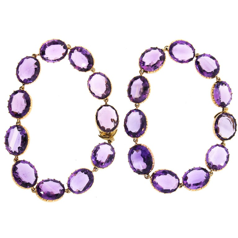 A pair of late Victorian collet set oval amethysts bracelets that can be made into a necklace in a fitted box. The perfectly matched amethysts make a striking pair. They are set in 15k gold and the well made settings show the shape and color of