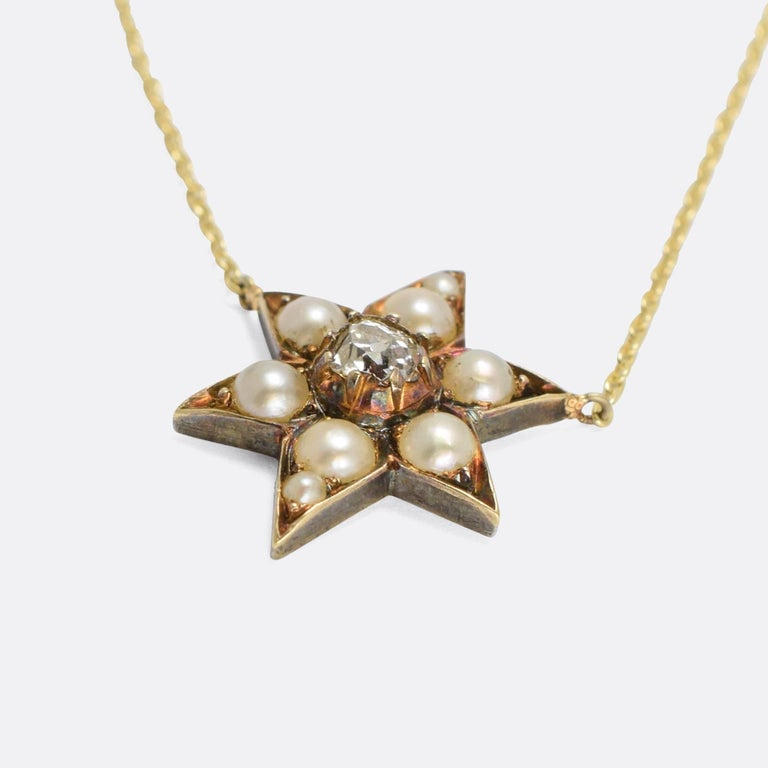 A wonderful Victorian necklace, the pendant modelled as a six pointed star and set with natural pearls and an old mine cut diamond. We've added a gold chain to what was once a brooch, giving it a new lease of life. The piece dates from the