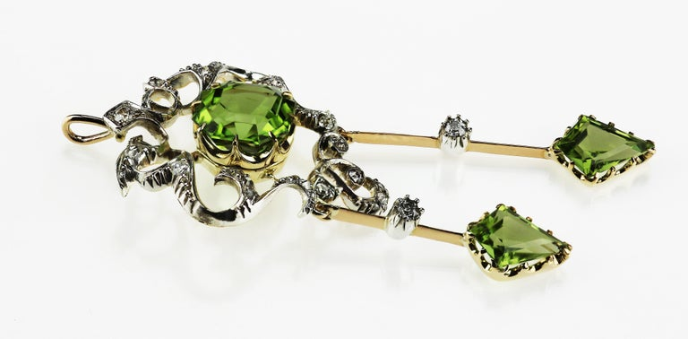 Emerald Cut Antique Victorian Peridot and Diamond Pendant Brooch in 18 Karat Gold and Silver For Sale