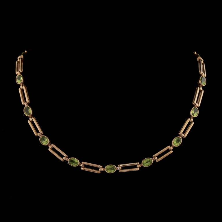 To read more please click continue reading below-  This magnificent antique 9ct Rose Gold Peridot necklace is Victorian Circa 1890.   The lovely necklace is adorned with fabulous, rich green Peridot's which cascade down the piece.   The Peridot is a