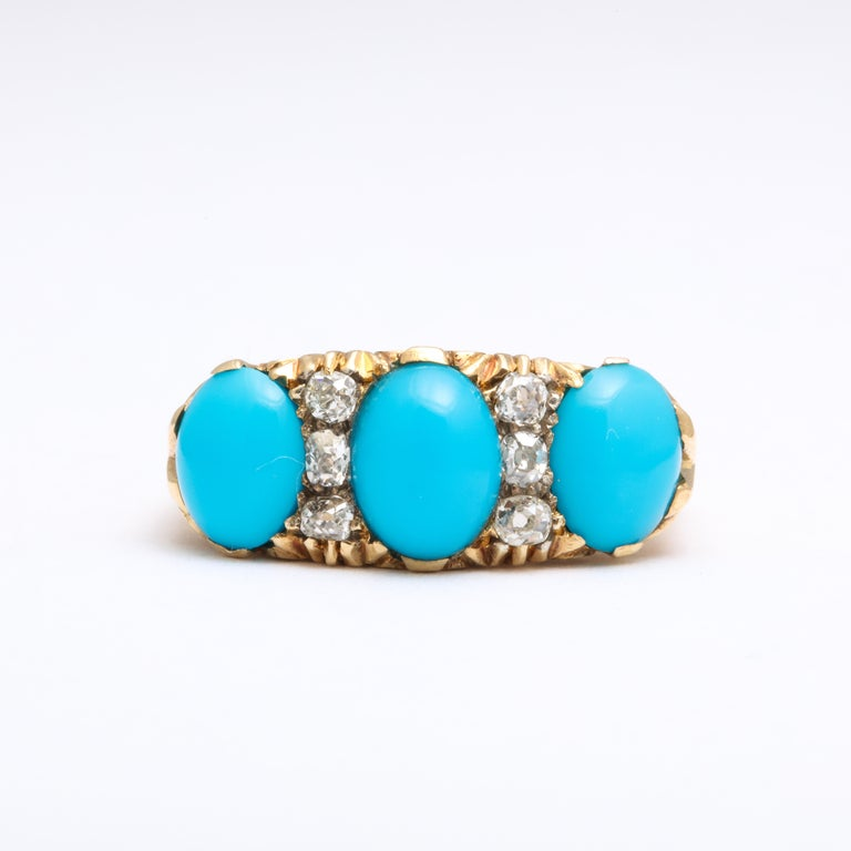 Not a wallflower but a bigger and bold example of a Victorian 18 Kt gold natural turquoise and diamond ring. The Persian cabochon turquoise is robin egg blue totaling 4 cts in weight. They are unmarred. Antique cut diamonds of .50 cts are white