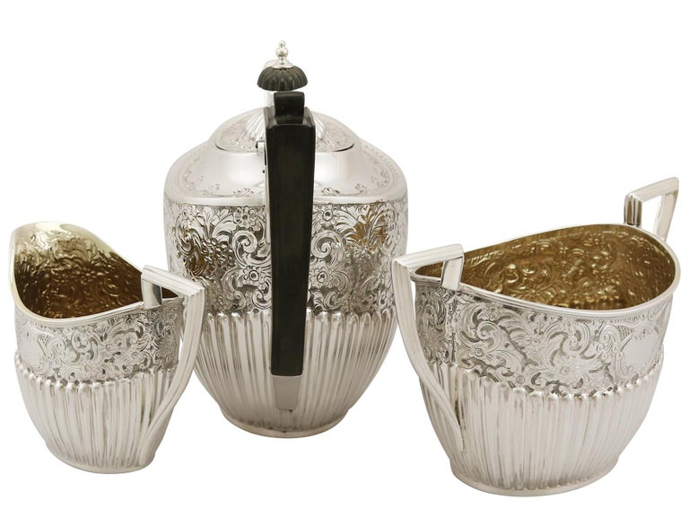 A fine and impressive antique Victorian English sterling silver three piece tea service / set in the Queen Anne style; part of our silver teaware collection.