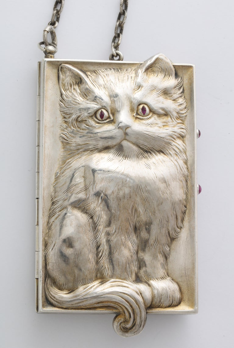 Ecompromised. The inner portion is normal wear with age as I have described. Weight 239 grams. Worth its weight in love. Cat lovers will cherish this beautifully made object d'Art. Origin, German c.1920