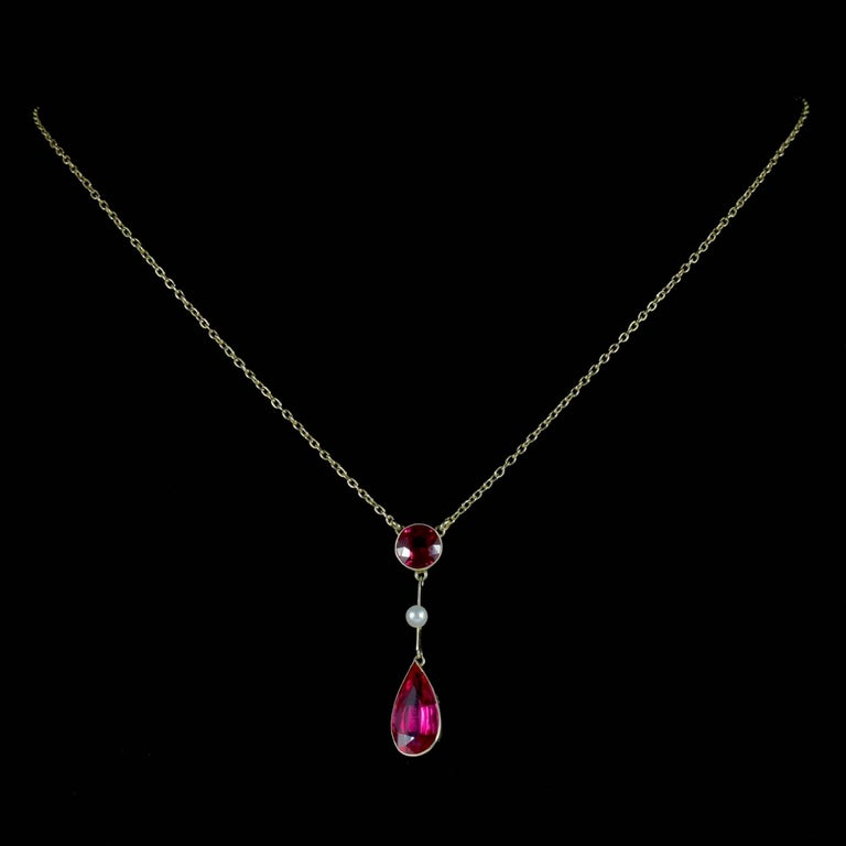 This beautiful antique Ruby and Pearl lavaliere necklace is Victorian Circa 1890.   The fabulous drop pendant displays a round 1.50ct Ruby at the top leading down to a lovely Pearl and a larger 4ct Ruby in the shape of a teardrop.  Ruby is