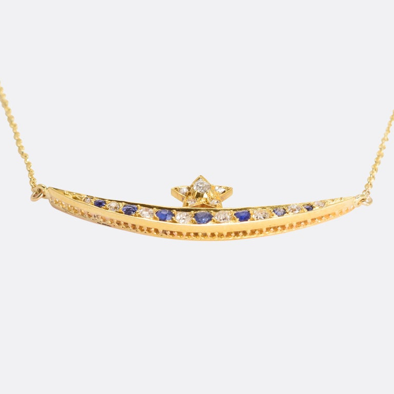 A gorgeous Victorian star and crescent necklace set with old cut diamonds and blue sapphires. We've added a fine gold chain, turning what was a brooch into a very wearable pendant necklace. Modelled in 15 karat gold, it dates from the late 19th