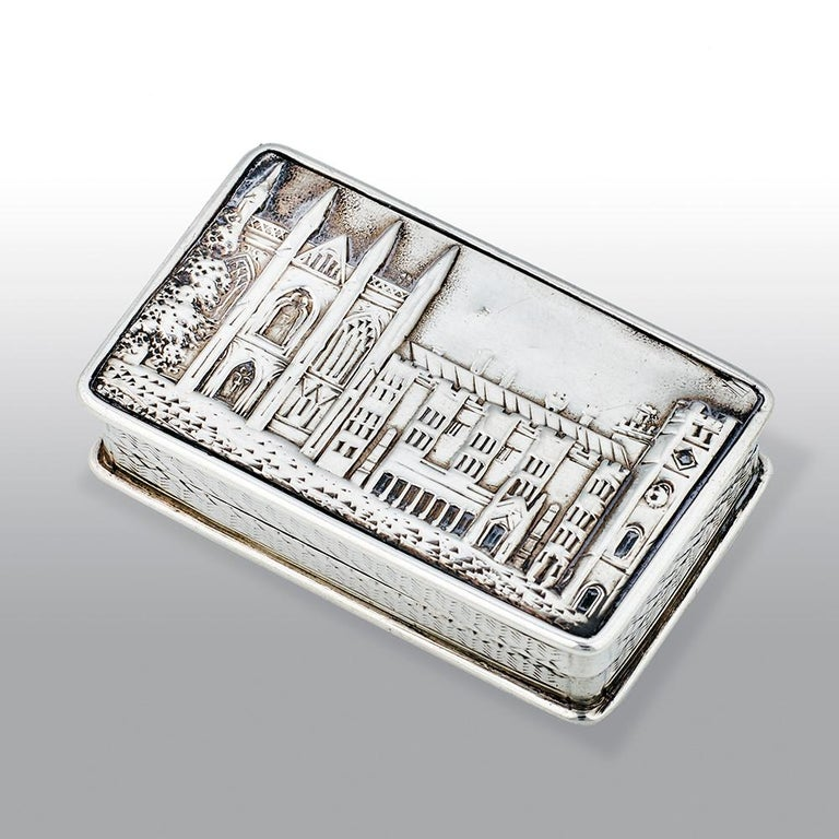 An exceptional, fine antique Victorian silver castle top vinaigrette depicting Newstead Abbey in high relief, of shaped rectangular form with engine turned sides and base. The silver gilt interior with finely pierced scroll grille. 