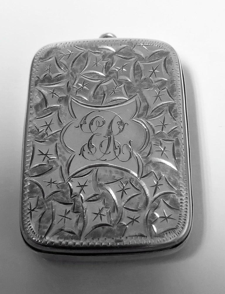 Antique Victorian silver puzzle vesta case, Birmingham 1898 Joseph Gloster. Rectangular cushion form with push 'puzzle' hinge to open. Cover and interior hallmarked. Elaborately engraved decoration, centre engraved ER. Gilded hallmarked interior.