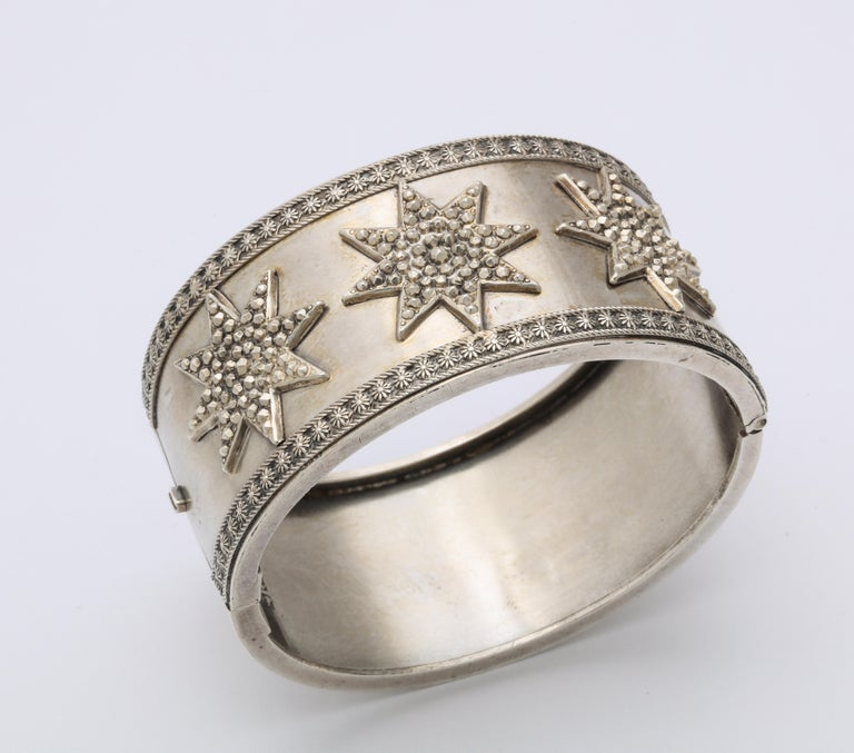 A dazzling, Victorian sterling bracelet, chock full of hand engraving, struck with three faceted raised stars, is one of the more unusual bracelets made during the silver revolution in Great Britain from c.1860-1880. I have not seen another. Note