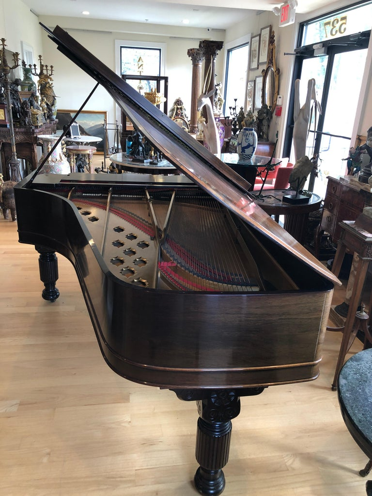 Fabulous 1870 Victorian Steinway Grand Piano with 85 keys (88 keys was not introduced until 1893). Stunning rosewood case. This piano was restored by Steinway 20 years ago. Carved legs and music rack.