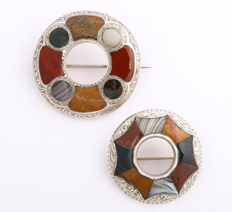 Victorian Scottish Agate brooches are boundlessly artistic in the creation of joyful, natural color palettes and the cut and set of the stones. They are patchwork quilts of nature. The two pictured are set with unusual mustard colors and striped