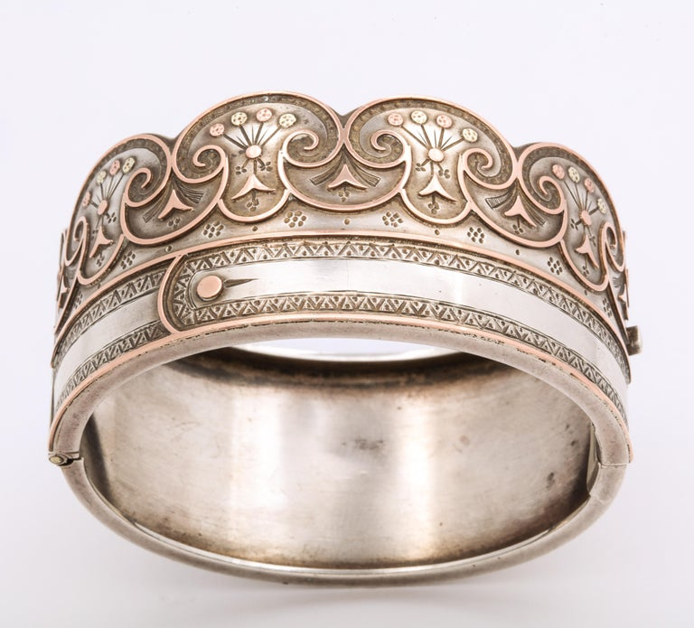 A curvaceous and unique Sterling and Gold Victorian Bracelet with the special meaning of the buttoned cuff that symbolizes joining two to become one e.g. as lovers, as husband and wife, in friendship or even two of the same mind. The scalloped