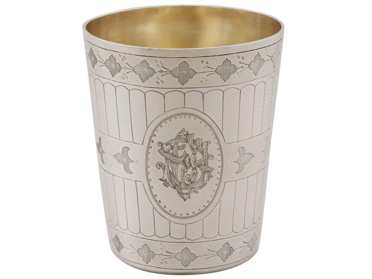 An exceptional, fine and impressive antique Victorian English sterling silver beaker, boxed; an addition to our ornamental silverware collection  This exceptional antique Victorian sterling silver beaker has a tapering cylindrical form.  The