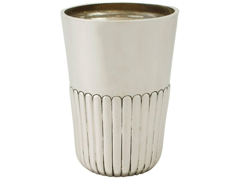 An exceptional, fine and impressive antique Victorian English sterling silver beaker by Charles Boyton II; an addition to our ornamental silverware collection.  This exceptional antique sterling silver beaker has a plain tapering cylindrical,