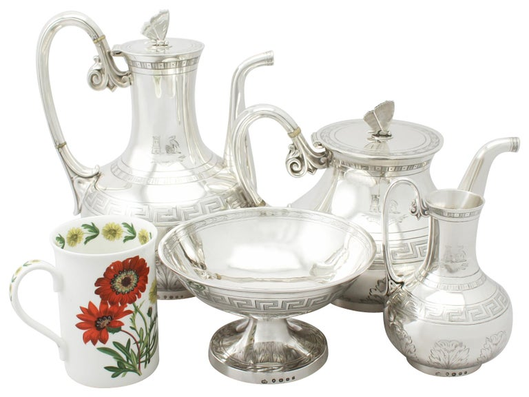 A fine, impressive and unusual antique Victorian English sterling silver composite four piece tea and coffee service / set in the Aesthetic style; part of our silver teaware collection.  This exceptional and unusual Victorian sterling silver tea