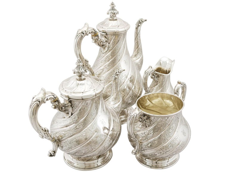 An exceptional, fine and impressive, composite antique Victorian English sterling silver four-piece tea and coffee service/set; part of our silver teaware collection.