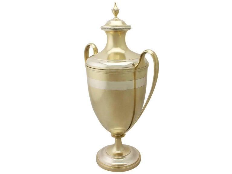 A magnificent, fine and impressive antique Victorian English sterling silver presentation cup and cover; an addition to our silver presentation collection  This magnificent antique Victorian silver cup and cover, in sterling standard, has a plain
