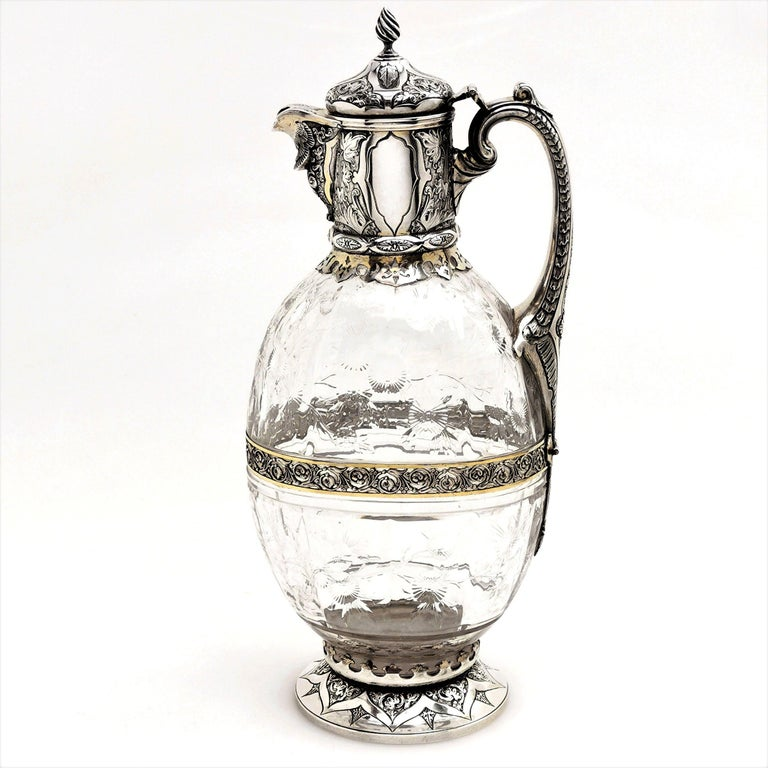 A beautiful antique Victorian silver and parcel-gilt cut glass claret jug or wine decanter.