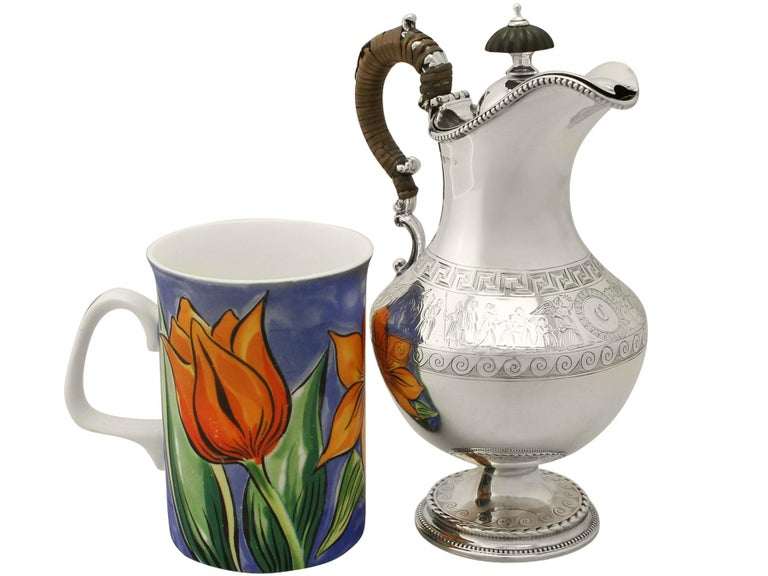 A fine and impressive antique Victorian English sterling silver wine/water jug, an addition to our antique silverware collection.