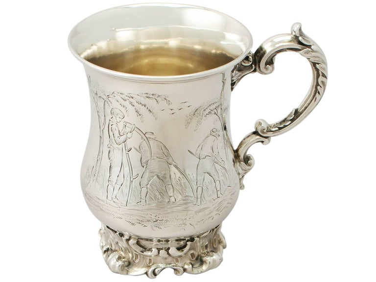 An exceptional, fine and impressive antique Victorian English sterling silver mug, made by Edward, John & William Barnard; an addition to our silver christening gifts collection  This exceptional antique Victorian sterling silver mug has a